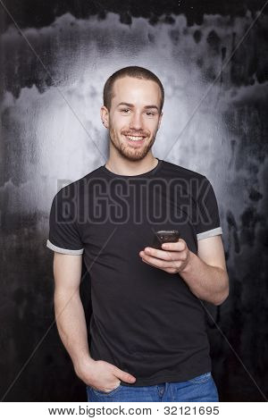 Smiling Guy With Smartphone Typing Sms