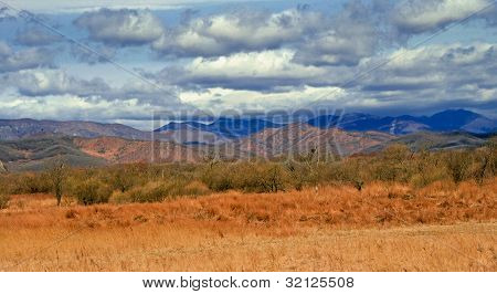 View Of Mountain Peaks In Spring Time