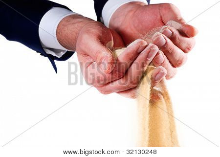 sand pouring out of businessman hands