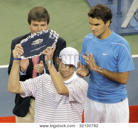 FLUSHING, NY - SEPTEMBER 10: Andy Roddick holds his award after losing to Roger Federer at the US Open at the USTA National Tennis Center on September 10, 2006 in Flushing, NY.