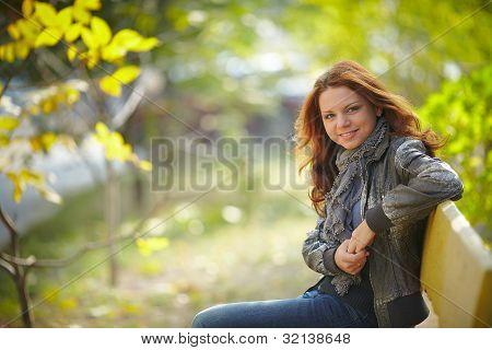 Happy girl in autumn park portrait