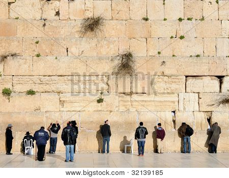 JERUSALEM - FEBRUARY 19: Jewish men pray at the western wall February 19, 2012 in Jerusalem, IL. The wall is one of the holiest sites in Judaism attracting thousands of worshipers daily.