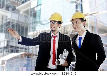 Asian Businessmen At Construction Site