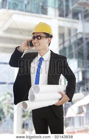 Asian Engineer Talking On The Phone