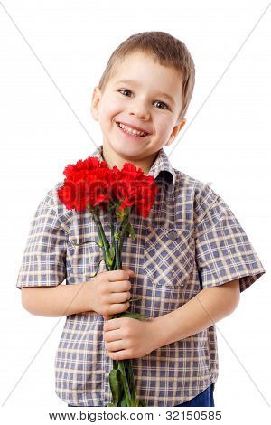 Smiling boy with bouquet of carnations