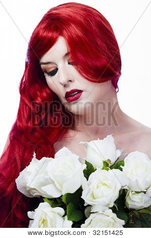 beautiful redhead, maid of honor at a wedding with bouquets of white roses