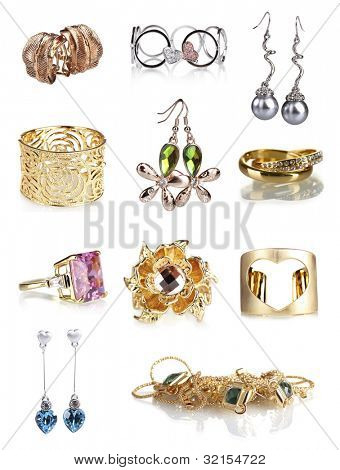 Beautiful gold jewellery collection isolated on white
