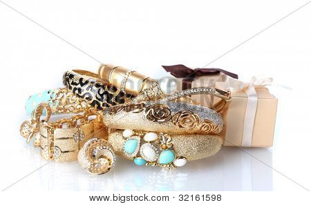 Beautiful golden jewelry and gifts boxes isolated on white