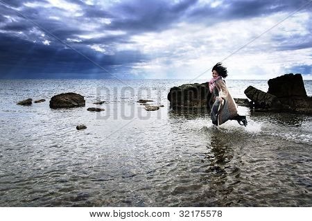 Free girl running in the sea