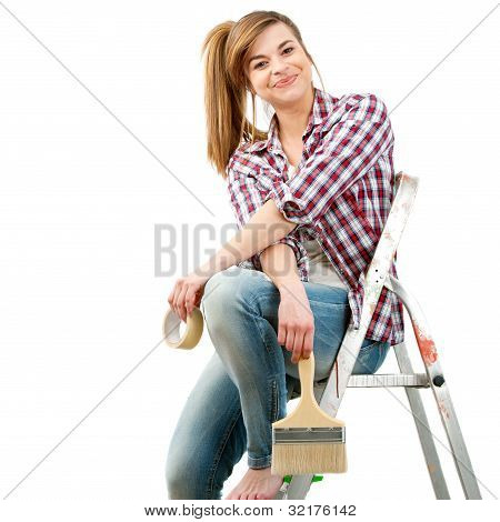 Cute Female Painter Sitting On Ladder.