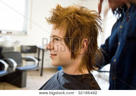 Smiling Young Boy With Red Hair At The Hairdresser