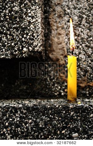 Yellow Candle on a Geometric Background