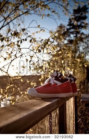 Shoes On A Railing