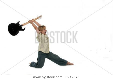 Boy In Rock Star Smashing Guitar Pose