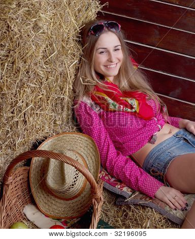 A beautiful girl is in the field