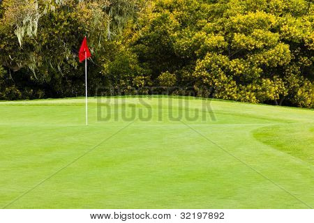 Beautiful Golf Green With Red Flag