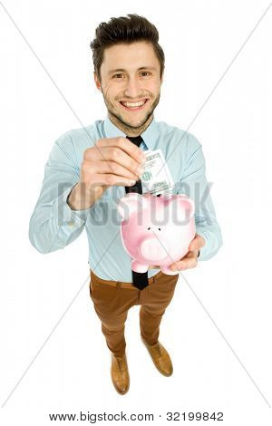 Man putting money in piggy bank