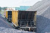 The Railway Carriage On Loading With Crushed Stone. Transportation Of Bulk Materials. Railway Track  poster