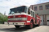 stock photo of firehose  - A fire truck parked in front of the station - JPG