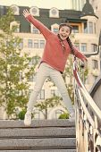 Running Down The Stairs. Happy Energetic Kid Jumping On Steps In Casual Wear. Energetic Little Girl  poster
