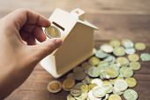 Business Men Put The Coin In House Style Piggy Bank To Save Money, Save Money On Investments, Spend  poster