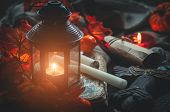 Close-up Glowing Lantern And Different Medieval Or A Fairy Tale Objects Such As Candles, A Rolled Le poster