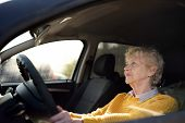 Portrait Of A Senior Business Woman Learning Drive A Car. Unsafety Drive. View Through Side Window. poster