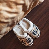 Slippers on floor at bedroom. Soft comfortable home slipper poster