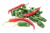 picture of pimiento  - green pimientos and red chillies in a heap on light background - JPG