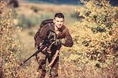 Bearded Serious Hunter Spend Leisure Hunting. Hunter Hold Rifle. Man Wear Camouflage Clothes Nature  poster