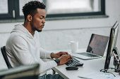 Selective Focus Of Attentive African American Programmer Working On Computer In Office poster