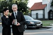Upset Woman Standing Near Bearded Man With Mortuary Urn poster