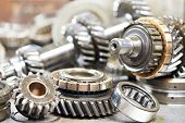 Close-up of automobile engine steel gears and bearings disassembled for repair at car service statio