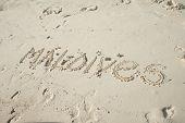 Inscription Maldives On White Sand. Maldives Island poster