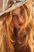Close-up portrait of a beautiful girl with magnificent foxy hair. Beauty and hair concept. Hippie st poster