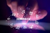 Finger touching tablet with drawn social media icons and FEEDBACK inscription, social networking con poster