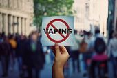 Human Hand Holding A Protest Banner Stop Vaping Message Over A Crowded Street Background. Banning Fl poster