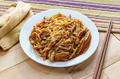 Chinese Shredded Pork Peking Style With Vegetables And Chopsticks poster