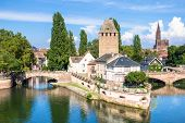 An image of a Strasbourg scenery water towers poster