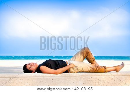 Woman laying on beach.