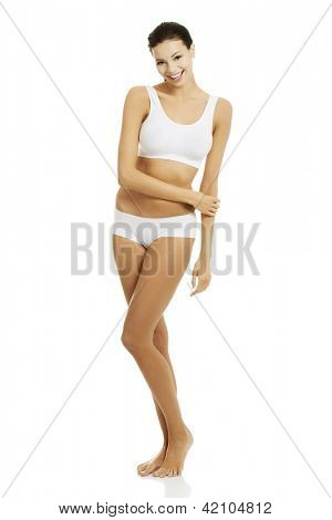 Taned happy fit woman in casual underwear. Diet, healthy lifestyle and body care concept.