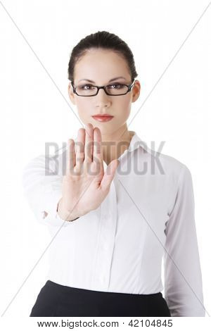 Serious businesswoman gesturing stop with her hand