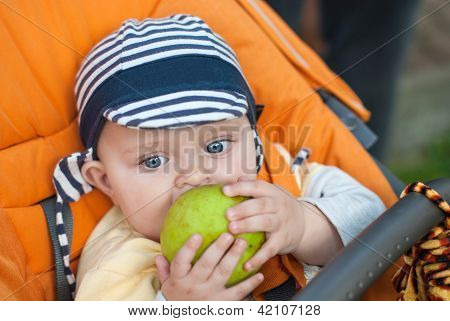 Lovely Baby Boy Outdoor Eating Apple