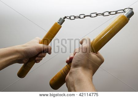 Hands Holding Nunchaku