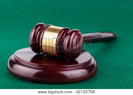 Gavel On Green Background