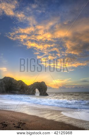 Colourful Winter Sunrises Behind Durdle Door On Jurassic Coast In England