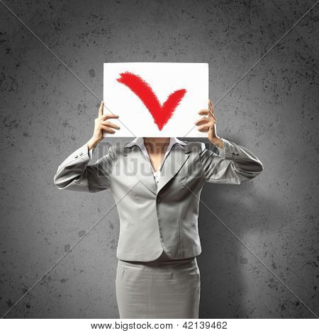 Image of businesswoman holding message board. Conceptual photo