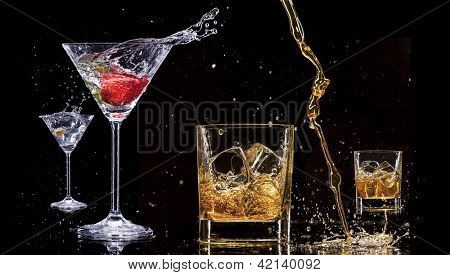 Alcohol drinks with splashes, isolated on black background