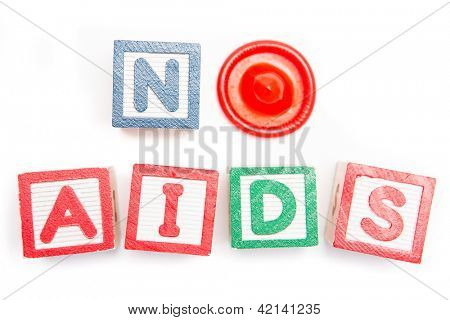 No aids spelled out in blocks and a condom on white background