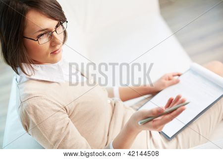 Professional psychiatrist looking at her patient during therapy session